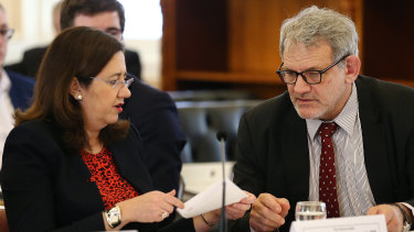 Premier Annastacia Palaszczuk speaks with Chief of staff David Barbagallo during estimate hearings last week.