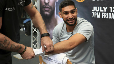 Britain's Amir Khan claimed on Tuesday that a deal to fight Filipino legend Manny Pacquiao had been signed.