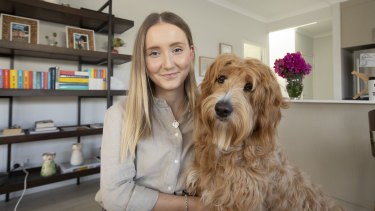 P&N Bank processing officer Emily Brown at home with her dog Tilly.