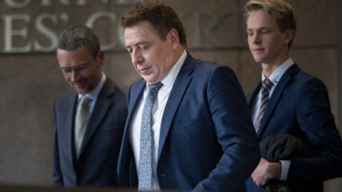Mark Thompson (centre) leaves court with his lawyer, Peter Matthews (left) in 2019.