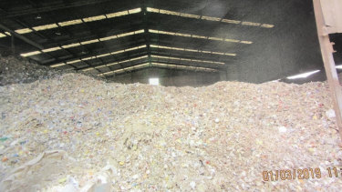 Mounds of waste at the glass sorting plant.