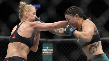 Trading blows: Holly Holm and Raquel Pennington during their bantamweight bout at UFC246.