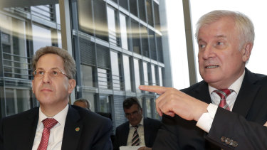 Hans-Georg Maassen, left, head of the German Federal Office for the Protection of the Constitution, and German Interior Minister Horst Seehofer, right, pictured on September 12.`