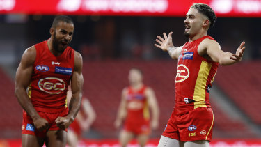 Bound for glory: Gold Coast's Izak Rankine on debut against Melbourne.
