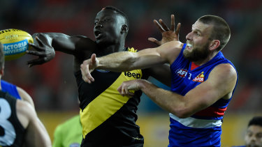 Out-gunned: Tiger Mabior Chol clears ahead of Bulldog Jackson Trengove.