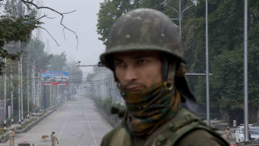 An Indian soldier guards a deserted road  during lockdown in Srinagar, Indian controlled Kashmir, on Thursday.