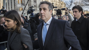 Michael Cohen arrives at court this week flanked by his daughter (left) and son (right).