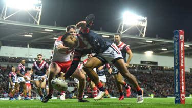 Daniel Tupou scores the Roosters' opening four-pointer.