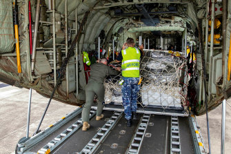 A pallet of humanitarian stores is loaded onto a Royal Australian Air Force C130J Hercules transport aircraft at HMAS Albatross, Nowra, New South Wales.