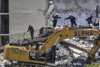 A Florida rescue team searches for survivors amid the rubble.