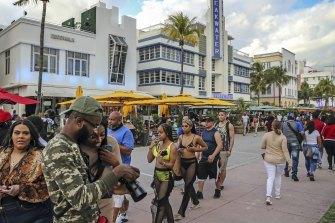 Despite the coronavirus, spring breakers - pictured last week - have returned to Miami.