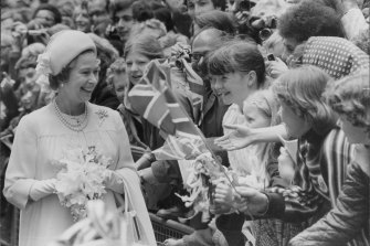 Jubilee smiles: A memorable moment for young children as the Queen walks through the city of London from St Paul's Cathedral to the Guildhall in 1977.