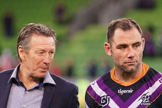 Cameron Smith, right, is close to surpassing the try tally of coach Craig Bellamy, left.