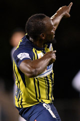 Trademark celebration: Usain Bolt enjoys his first strike.