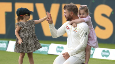 David Warner takes time out with his daughters after Australia's triumph at Edgbaston.