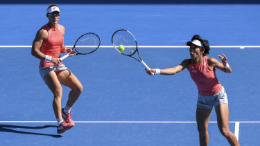Stosur and Zhang cover the court at Melbourne Park.