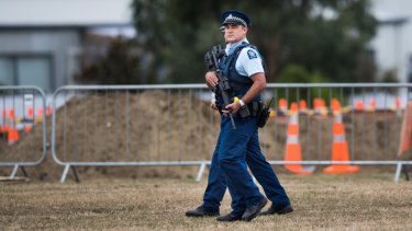 Heavily armed New Zealand Police patrol the Memorial Park Cemetery as 50 graves are being dug for the victims of Friday's attacks.