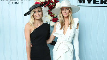 Mind the gap: Elyse Knowles and Jennifer Hawkins on Derby Day in Melbourne.