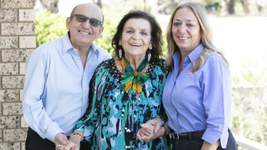 Family matriarch Alice Xyrakis (centre) with son Manuel and daughter Irene.