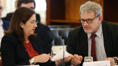 Premier Annastacia Palaszczuk with her chief of staff David Barbagallo during estimate hearings on July 23.