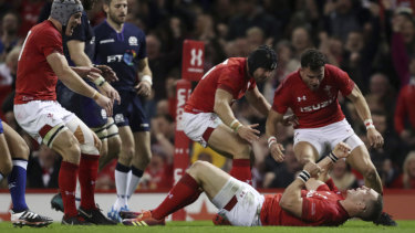 Enter the Dragons: Wales celebrate a try from George North against the Scots.