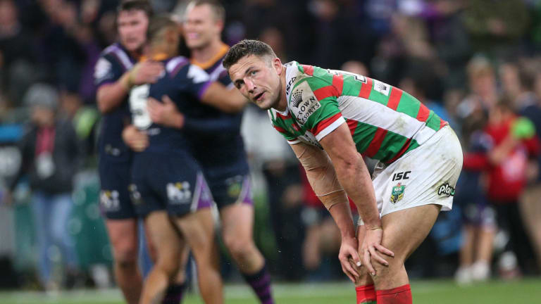 Hard night as the office: Sam Burgess takes in defeat after absorbing some serious punishment.