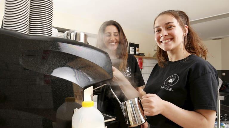 Amy Zerafa, 15, makes a coffee as her teacher Seral Fehmi looks on.
