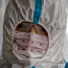 A Chinese traveler wearing a protective suit passes through a decontamination tent upon arriving at Ninoy Aquino International Airport in Manila, Philippines.