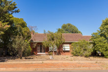 The three-bedroom, one-bathroom house on 875sq m at 40 Portland Road in northern Adelaide's Elizabeth East sold at auction for $198,500.
