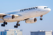 Los Angeles, California / USA - September 22, 2019: A close up view of a Hawaiian Airlines Airbus A330 on final approach into Los Angeles International airport, the flaps have been extended and the landing gear is down in preparation for landing.  There are several tall buildings in the background. iStock image for Traveller. Re-use permitted. Hawaiian Airlines Airbus A330