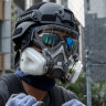 Violence escalates on Hong Kong streets as Carrie Lam heads to Beijing