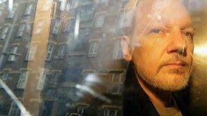 Julian Assange being taken from court last year.