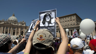 Demonstrators hold pictures of Emanuela Orlandi in St. Peter's Square in 2012.