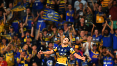 Timely try: Mitchell Moses did his contract value no harm when he ran 80m to score the opening try at the new Bankwest Stadium.