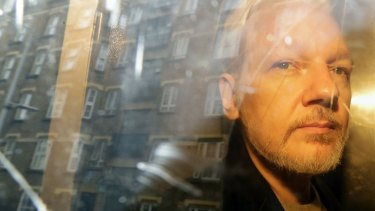 Julian Assange pictured in May being taken from court.