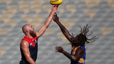 Big men fly: Eagle's Nic Naitanui come up trumps in the highly-anticipated ruck match-up against Melbourne captain Max Gawn.