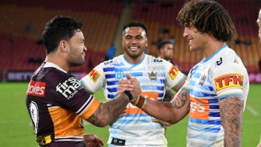 Broncos player Issac Luke shares a laugh with some of his rivals from the Titans last week.