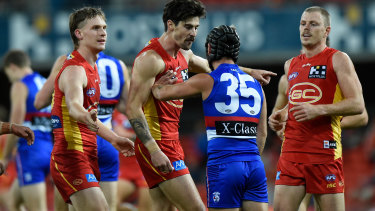 Alex Sexton of the Suns exchanges words with Dog Caleb Daniel.