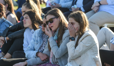 Fans at Moorabbin Oval during the emotional service for Frawley.