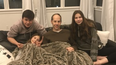 Daniel Clarke, here with his children Sarah, Josh and Katelyn, is now in remission.