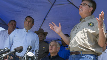 Senator Ted Cruz, second from left, Texas Governor Greg Abbott, second from right, and Lieutenant Governor Dan Patrick, right, speak at a press conference in the wake of the Santa Fe shooting.