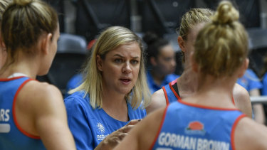 """Warning: NSW Swifts coach Briony Akle (centre) says netball """"can't be complacent""""."""