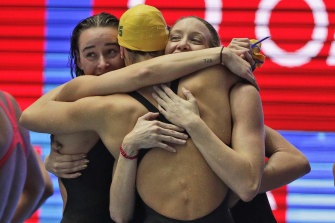 Australia's women's 4x200m freestyle relay team celebrate after wining the final at the World Swimming Championships.