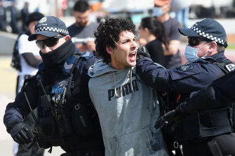 Police arrest a vocal protester on Saturday.