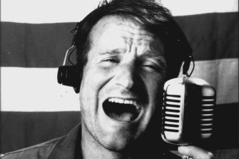 Robin Williams as Adrian Cronauer in Good Morning Vietnam.
