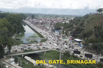 This frame-grab from a video released on August 10, 2019, by the Jammu and Kashmir government purports to show life returning to normal at Dal Gate in Srinagar, Indian-controlled Kashmir.