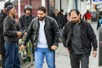 Al Noor Mosque shooting survivor Wasseim Alsati (centre) leaves Christchurch High Court during Brenton Tarrant's sentencing hearing on Monday morning.