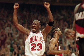 Michael Jordan celebrates the Bulls' win over the Portland Trail Blazers in the NBA Finals in Chicago in June 1992.