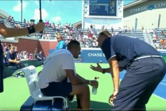An umpire gives Nick Kyrios a pep talk at the US Open.
