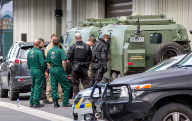 Police are seen at the Christchurch District Court precinct for the arrival of gunman Brenton Tarrant on charges of murder following the mass shootings at the Masjid Al Noor mosque, in Christchurch, New Zealand.